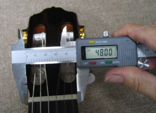 Measuring 48mm nut wdith of Esteve Guitar