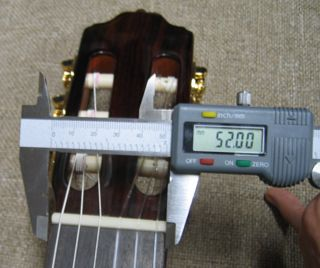 Measuring 52mm nut width of Esteve R.Fernandez 40 Guitar